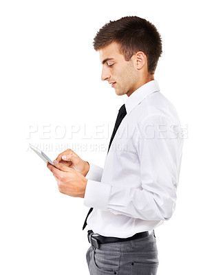 Buy stock photo A side view of a man concentrating on his touch screen