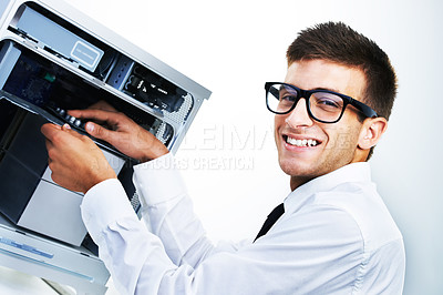 Buy stock photo A smiling hipster working on an electronic appliance