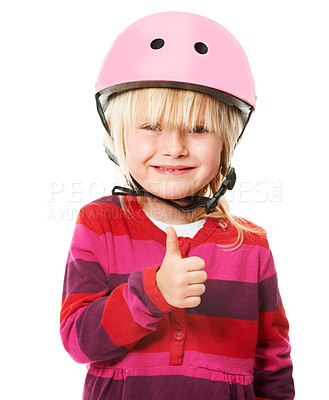 Buy stock photo Studio shot of a cute little blonde girl wearing a cycling helmet showing thumbs up