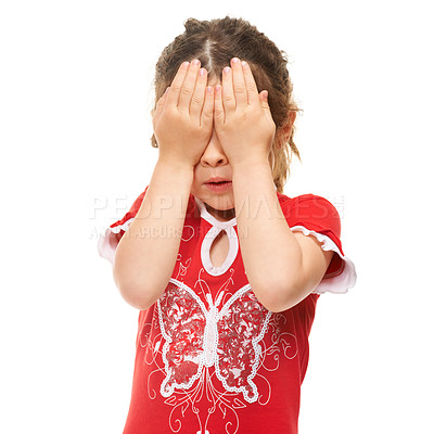 Buy stock photo Cute little girl covering her eyes against a white background