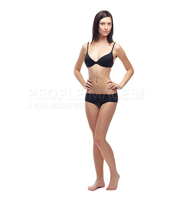 Buy stock photo A slim young woman in her underwear isolated on a white background
