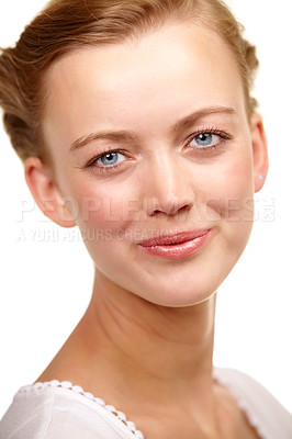Buy stock photo Studio portrait of a beautiful young woman smiling subtly at the camera