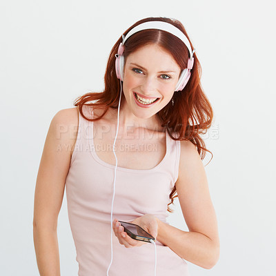 Buy stock photo Portrait of a young woman holding an mp3 player