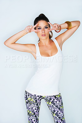 Buy stock photo Studio portrait of an attractive young woman gesturing for the camera