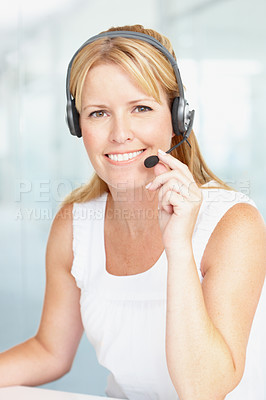 Buy stock photo A mature businesswoman wearing a headset