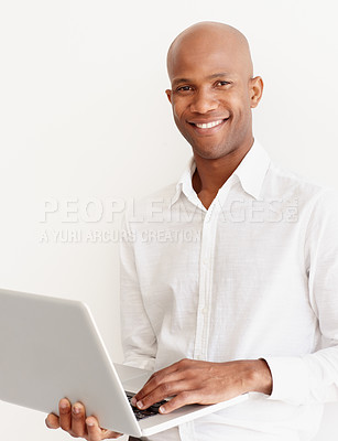 Buy stock photo A young entrepreneur working on his laptop