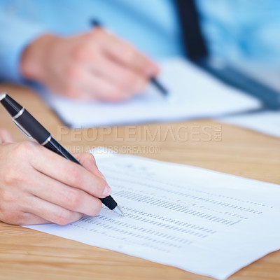 Buy stock photo Two businesspeople sign off on a document