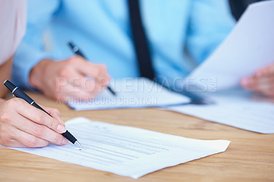 Buy stock photo Two accountants check some documents