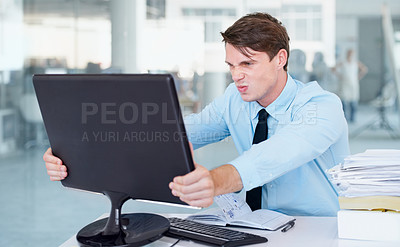 Buy stock photo A businessman angrily gripping his computer screen