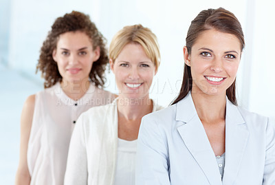 Buy stock photo A group of female executives standing together confidently