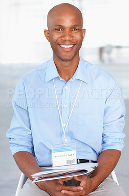 Buy stock photo A young businessman attending a seminar with a big smile on his face