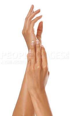 Buy stock photo Shot of a beautiful woman's hands isolated on white
