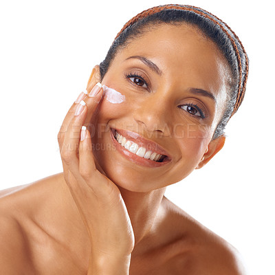 Buy stock photo Closeup portrait of a gorgeous young woman applying moisturizer to her skin