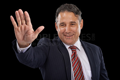 Buy stock photo A man in a suit waving on a black background