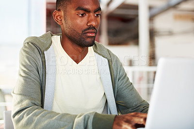 Buy stock photo A young african man working on his laptop