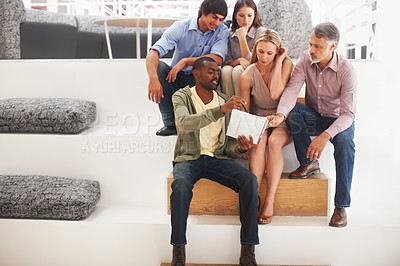Buy stock photo A team of designers brainstorming some ideas