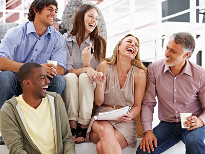 Buy stock photo A team of designers laughing at their colleague's joke