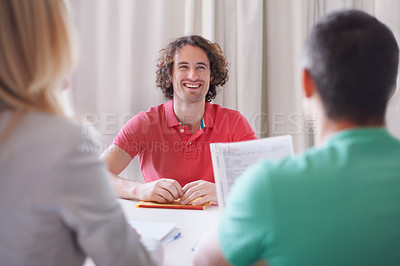 Buy stock photo Cropped shot of a young man sitting in a job interview