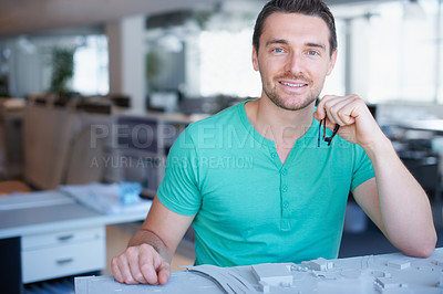 Buy stock photo Cropped shot of a businessman working on his building project
