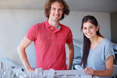 Buy stock photo Cropped shot of two young businesspeople working on their building project