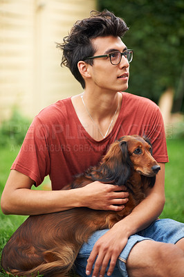 Buy stock photo Young guy with his dog outdoors