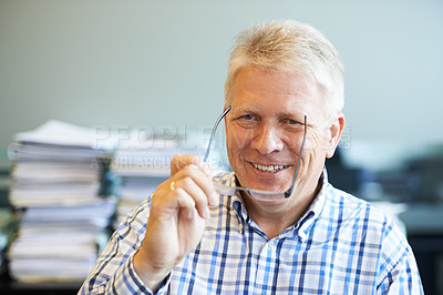 Buy stock photo Portrait of a senior businessman sitting in his office