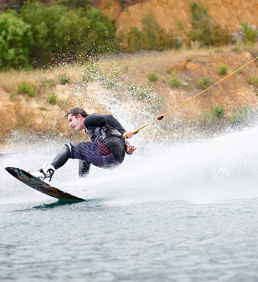 Buy stock photo Sporty young guy out wakeboarding on the lake