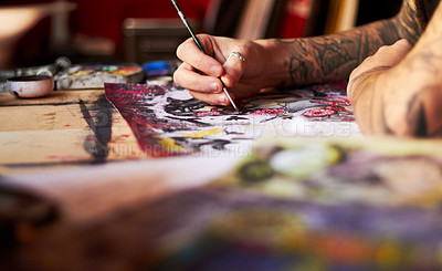 Buy stock photo A closeup of a tattoo artist using colour and a paintbrush working on his latest piece of art work