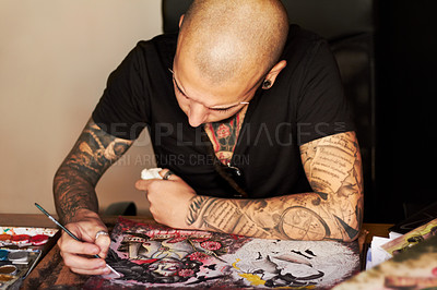 Buy stock photo A young man drawing a tattoo design