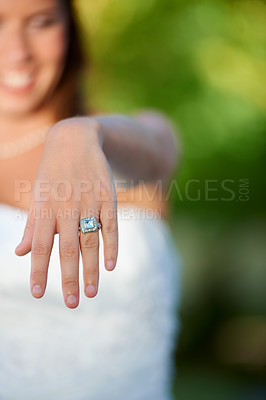 Buy stock photo Cropped closeup shot of a young bride showing off her wedding ring to the camera