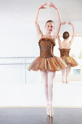 Buy stock photo Full length shot of a young ballerina rehearsing in a studio with a mirror behind her