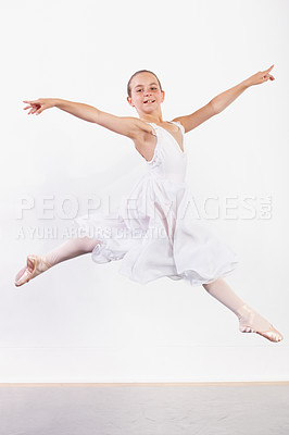 Buy stock photo Shot of a young ballerina leaping across the floor of a dance studio