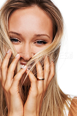 Buy stock photo A playful young woman with her hands in her hair - isolated