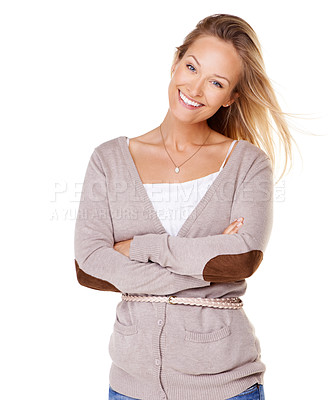 Buy stock photo Lovely young woman smiling at the camera with her arms folded - isolated