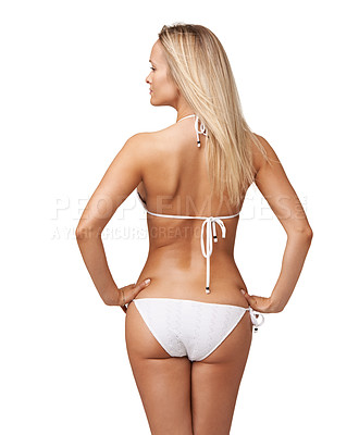 Buy stock photo Rearview of a gorgeous young woman in a bikini standing against a white background