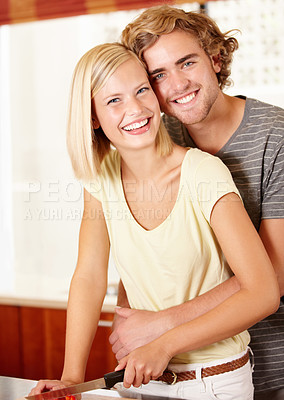 Buy stock photo Portrait of a young couple standing in the kitchen