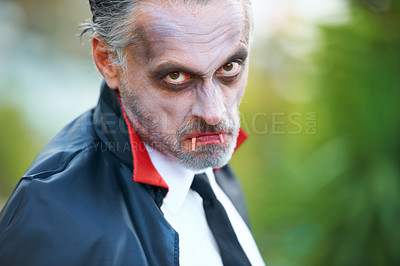 Buy stock photo Mature man dressed up as Dracula for Hallowe'en, scowling at the camera