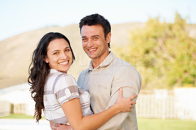 Buy stock photo A cute couple embracing outdoors