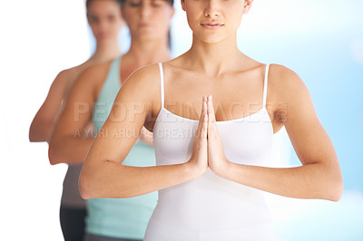 Buy stock photo Group of serene yoga practitioners meditating together - cropped