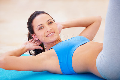 Buy stock photo Young woman doing a sit up during pilates