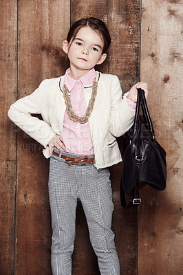 Buy stock photo Portrait of an adorable little girl dressed fashionably