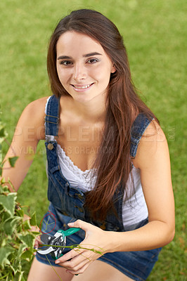 Buy stock photo Portrait of a beautiful young woman pruning her hedges
