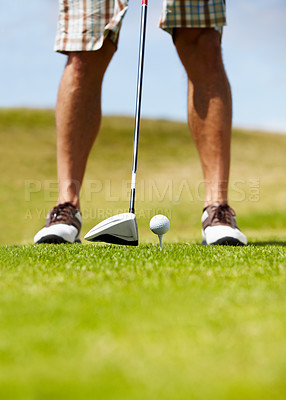 Buy stock photo Cropped image of a golfer about to smack the golfball down the fairway