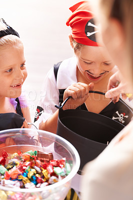 Buy stock photo A brother and sister receive sweets from a neighbor on halloween