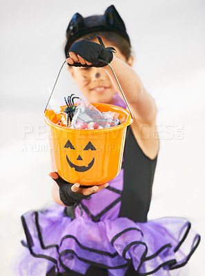 Buy stock photo Little girl dressed in a Halloween costume holding a candy bucket