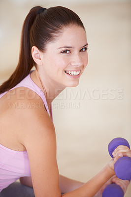 Buy stock photo Portrait of a happy young woman lifting a dumbbell with one arm