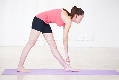 Buy stock photo Profile shot of a young woman exercising in a health club