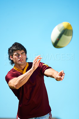 Buy stock photo Cropped shot of a young rugby player executing a pass