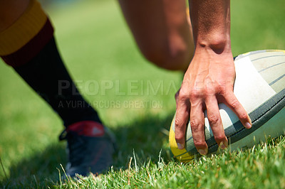 Buy stock photo Closeup shot of a man's hand on a rugby ball