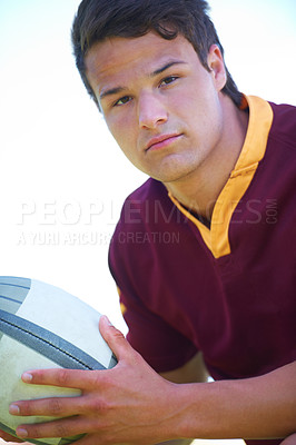 Buy stock photo Cropped portrait of a young rugby player holding a ball